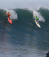 Evan Slater, right, and Randy Cone, left, take off on a wave during the 2008 Mavericks Surf Contest in Half Moon Bay, Calif., Saturday, January 12, 2008.