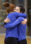 Marymount's Cassidie Watson hugs Courtney Phung before a college volleyball game in Lexington Park, MD, on Wednesday, Oct. 29, 2014. Marymount won 3-2 to go 24-9 on the season.<br /> Photo by Cathleen Allison