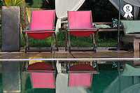 Wooden pink seats reflected in pool (Licence this image exclusively with Getty: http://www.gettyimages.com/detail/84869031 )