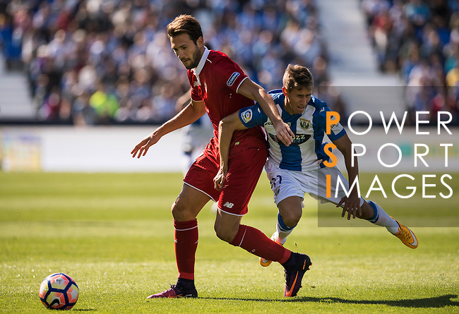 Franco Vazquez of Sevilla FC battles for the ball with Alexander Szymanowski of Deportivo Leganes during their La Liga match between Deportivo Leganes and Sevilla FC at the Butarque Municipal Stadium on 15 October 2016 in Madrid, Spain. Photo by Diego Gonzalez Souto / Power Sport Images