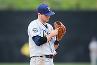 Princeton Rays third baseman Seaver Whalen (7) rubs the palm of his glove during the game against the Danville Braves at American Legion Post 325 Field on June 25, 2017 in Danville, Virginia.  The Braves walked-off the Rays 7-6 in 11 innings.  (Brian Westerholt/Four Seam Images)