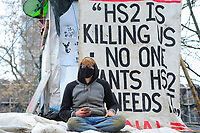 A protester looks on during a protest against the building of the HS2 railway line at Euston Square Gardens on 27th January 2021