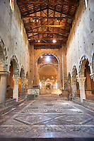 Naive and Lombard inlaid marble floor of the Lombard masters Cosmatesque association in the Romanesque interior of the 8th century Romanesque Basilica church of St Peters, Tuscania, Lazio, Italy