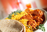 Chicken Tikka Masala - Pilau rice & naan bread in white dish with red background  Indian food stock pictures, photos fotos & images
