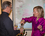 """Deborah Green, right, pours sparkling wine during the Reno Magazine """"Bubbles Tasting"""" event at Total Wine in Reno on Friday night, February 9, 2018."""