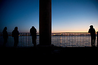 Silhouette of people in front of the river Mersey, Liverpool, England, UK