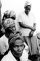 """Angola. Province of Bié. Kuito. Women wear their nice sunday dresses and listen to a mass service of the protestant church """"Igreja Evangelica dos Irmaos em Angola"""". © 2000 Didier Ruef"""