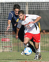 Graham Zusi #11 of the University of Maryland breaks past Anthony Avalos #4 of the University of California during an NCAA championship round of sixteen soccer match at Ludwig Field, on November 29, 2008 in College Park, Maryland. The match was won by Maryland 2-1