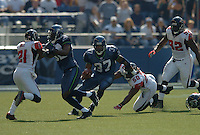 Sep 18, 2005; Seattle, WA, USA; Seattle Seahawks running back Shaun Alexander #37 rushes the ball against the Atlanta Falcons during the second quarter at Qwest Field. Mandatory Credit: Photo By Mark J. Rebilas