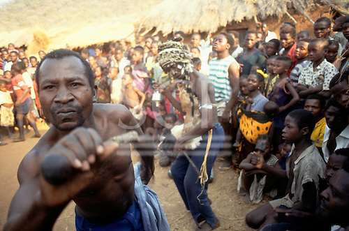Yumba Bay, Tanzania. Village shamans (witch doctors) dancing a ritual in front of the whole village.