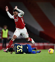17th December 2020, Emirates Stadium, London, England;  Arsenals Gabriel is tackled by Southamptons Walcott during the English Premier League match between Arsenal and Southampton