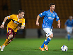 St Johnstone v Motherwell....31.10.14   SPFL<br /> Chris Millar is tracked by Steven Hammell<br /> Picture by Graeme Hart.<br /> Copyright Perthshire Picture Agency<br /> Tel: 01738 623350  Mobile: 07990 594431