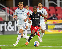 WASHINGTON, DC - MAY 13: Moses Nyeman #27 of D.C. United dribbles during a game between Chicago Fire FC and D.C. United at Audi FIeld on May 13, 2021 in Washington, DC.