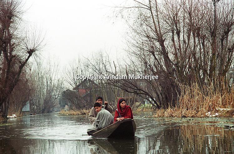 Residents of Dal lake commute by small boats. Srinagar, Jammu and Kashmir, India. Arindam Mukherjee