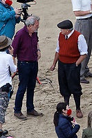Pictured: Hugh Laurie and Conieth Hill. Friday 18 June 2021<br /> Re: Film set with a scene being filmed with Hugh Laurie as a director at Three Cliffs Bay in the Gower Peninsula, Wales, UK.