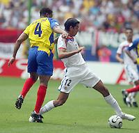Ecuador's Ulises De La Cruz (4) and Costa Rica's Leonadro Gonzalez (12) battle for the ball. Ecuador defeated Costa Rica 3-0 in their FIFA World Cup Group A match at FIFA World Cup Stadium, Hamburg, Germany, June 15, 2006.