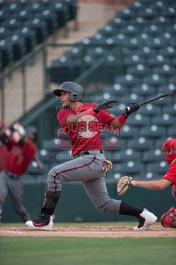 AZL Diamondbacks catcher Douglas Lanza (26) follows through on his swing during the completion of a suspended Arizona League game against the AZL Angels at Tempe Diablo Stadium on July 16, 2018 in Tempe, Arizona. The game was a continuation of the July 11, 2018 contest that was suspended by rain in the middle of the eighth inning. The AZL Diamondbacks defeated the AZL Angels 12-8. (Zachary Lucy/Four Seam Images)