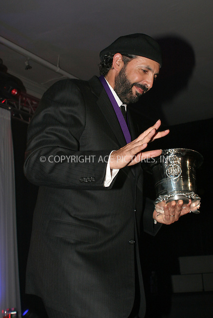 WWW.ACEPIXS.COM . . . . .  ....NEW YORK, APRIL 7, 2006....Juan Luis Guerra at the BMI 13th Annual Latin Music Awards held at the Metropolitan Pavillion.....Please byline: NANCY RIVERA- ACEPIXS.COM.... *** ***..Ace Pictures, Inc:  ..Craig Ashby (212) 243-8787..e-mail: picturedesk@acepixs.com..web: http://www.acepixs.com