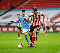 31st October 2020; Bramall Lane, Sheffield, Yorkshire, England; English Premier League Football, Sheffield United versus Manchester City; Sander Berge of Sheffield United on the break as he gets aways from Joao Cancelo of Manchester City
