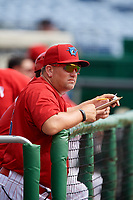 Clearwater Threshers pitching coach Aaron Fultz in the dugout during the first game of a doubleheader against the Lakeland Flying Tigers on June 14, 2017 at Spectrum Field in Clearwater, Florida.  Lakeland defeated Clearwater 5-1.  (Mike Janes/Four Seam Images)