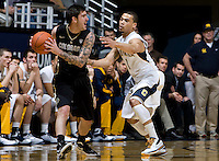 Nate Tomlinson of Colorado controls the ball away from Justin Cobbs of California during the game at Haas Pavilion in Berkeley, California on January 12th, 2012.   California defeated Colorado, 57-50.