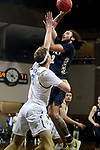 SIOUX FALLS, SD - MARCH 8: Kareem Thompson #2 of the Oral Roberts Golden Eagles shoots over Baylor Scheierman #3 of the South Dakota State Jackrabbits during the Summit League Basketball Tournament at the Sanford Pentagon in Sioux Falls, SD. (Photo by Dave Eggen/Inertia)