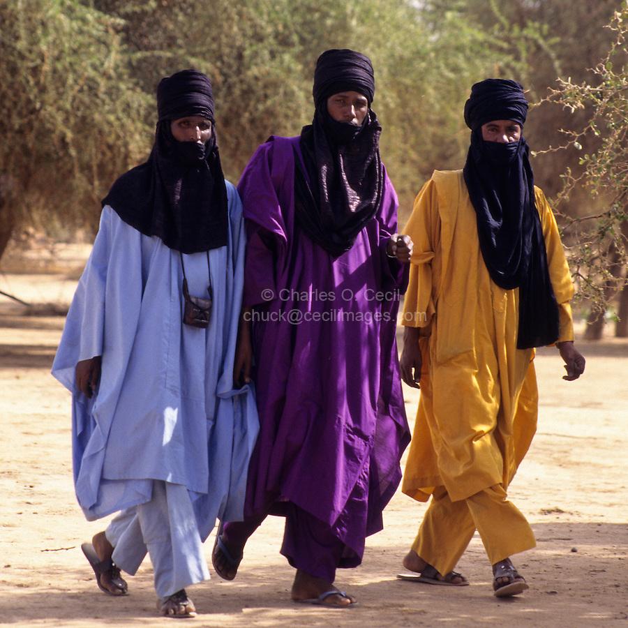 Akadaney, Central Niger, West Africa.  Fulani Nomads. Men Walking, Mouths Veiled in the Tuareg Fashion.  Annual Gathering, Geerewol.