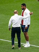 Eddie Jones head coach of England speaking to Joe Cokanasiga (Bath Rugby) of England ahead of the Autumn International match between England and Canada at Twickenham Stadium, London, England on 10 July 2021. Photo by Liam McAvoy.