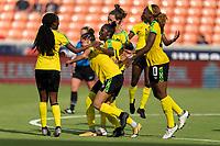 HOUSTON, TX - JUNE 10: Deneisha Blackwood #14 of Jamaica celebrates her goal with Havana Solaun #6 and Cheyna Matthews #20 during a game between Nigeria and Jamaica at BBVA Stadium on June 10, 2021 in Houston, Texas.