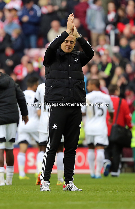 Pictured: Swansea manager Garry Monk thanks his away supporters after the final whistle. Sunday 11 May 2014<br /> Re: Barclay's Premier League, Sunderland v Swansea City FC at the Stadium of Light, Sunderland, UK.
