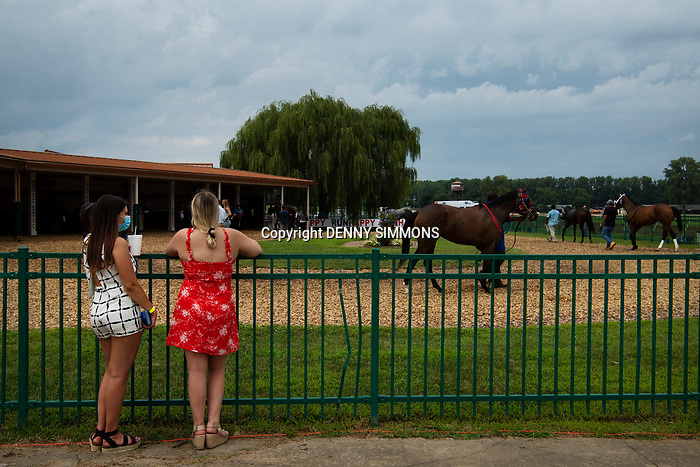 University of Kentucky students Claudia Sadler of Farmville, Va., and Brittany Willis of Houston, Tex., check out the horses in the paddock at Ellis Park in Henderson, Ky., Sunday afternoon, Aug. 9, 2020.