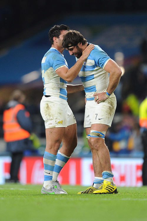 Juan Martin Fernandez Lobbe of Argentina is comforted by Jeronimo de la Fuente of Argentina during the Semi Final of the Rugby World Cup 2015 between Argentina and Australia - 25/10/2015 - Twickenham Stadium, London<br /> Mandatory Credit: Rob Munro/Stewart Communications