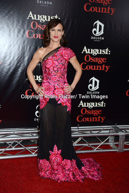 """Juliette Lewis in Naaen Khan pink flowered embroidered dress attends the New York Premiere of """"August: Osage County"""" on December 12, 2013 at the Ziegfeld Theatre in New York City."""