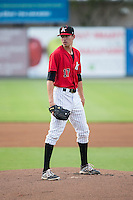 Kannapolis Intimidators starting pitcher Zack Erwin (17) looks to his catcher for the sign against the Hagerstown Suns at CMC-Northeast Stadium on August 16, 2015 in Kannapolis, North Carolina.  The Suns defeated the Intimidators 4-3 in game two of a double-header.  (Brian Westerholt/Four Seam Images)