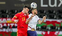 SWANSEA, WALES - NOVEMBER 12: Matt Miazga #3 of the United States  and Kieffer Moore #13 of Wales battle for an air ball during a game between Wales and USMNT at Liberty Stadium on November 12, 2020 in Swansea, Wales.