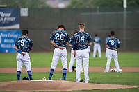 The Ogden Raptors infield stands at attention during the National Anthem before a Pioneer League game against the Billings Mustangs at Lindquist Field on August 17, 2018 in Ogden, Utah. The Billings Mustangs defeated the Ogden Raptors by a score of 6-3. (Zachary Lucy/Four Seam Images)