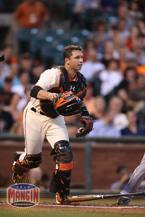 SAN FRANCISCO, CA - APRIL 30:  Buster Posey #28 of the San Francisco Giants chases a bunt against the San Diego Padres during the game at AT&T Park on Wednesday, April 30, 2014 in San Francisco, California. Photo by Brad Mangin