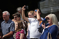 Pictured: People watching one of the performances on stage Saturday 13 August 2016<br />