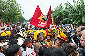 Kayapo Chief Raoni Metuktire, indigenous leaders Sheyla Juruna and Tabata Kuikuro and other indigenous leaders march at a demonstration by indigenous people, the Landless People's Movement (MST) and other civil society groups in front of the Riocentro United Nations conference. The demonstrators wanting to hand in a petition against the building of dams in the Amazon, are kept out of earshot and invisible to the UN conference. The United Nations Conference on Sustainable Development (Rio+20), Rio de Janeiro, Brazil, 20th June 2012. Photo © Sue Cunningham.