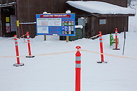 Orange construction pylons mark the lift lines at the bottom of the Payload triple chair at Showdown Ski Area on King's Hill in the Little Belt Mountains near Neihart, Montana, USA.