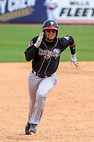 Lansing Lugnuts outfielder Norberto Obeso (9) races to third base during a Midwest League game against the Wisconsin Timber Rattlers on May 8, 2018 at Fox Cities Stadium in Appleton, Wisconsin. Lansing defeated Wisconsin 11-4. (Brad Krause/Four Seam Images)