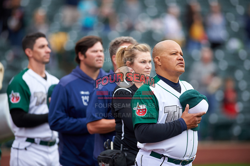 Fort Wayne TinCaps fielding coach Jhonny Carvajal (7) during the National Anthem before a Midwest League game against the Kane County Cougars at Parkview Field on May 1, 2019 in Fort Wayne, Indiana. Fort Wayne defeated Kane County 10-4. (Zachary Lucy/Four Seam Images)