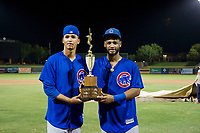 Brailyn Marquez (58) and Jonathan Sierra (22) hold the Chuck Jared Championship Cup after winning Game Three of the Arizona League Championship Series against the AZL Giants on September 7, 2017 at Scottsdale Stadium in Scottsdale, Arizona. AZL Cubs defeated the AZL Giants 13-3 to win the series two games to one. (Zachary Lucy/Four Seam Images)