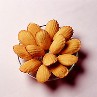 Bowl of Madeleine cookies photographed from above<br />