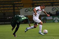 BOGOTA - COLOMBIA - 15 - 09 - 2017: Neider Barona (Izq.) jugador de La Equidad disputa el balón con Mateo Puerta (Der.) jugador de Cortuluá, durante partido entre La Equidad y Cortuluá,  por la fecha 12 de la Liga Aguila II-2017, jugado en el estadio Metropolitano de Techo de la ciudad de Bogota. /Neider Barona (L) player of La Equidad vies for the ball with Mateo Puerta(R) player of Cortulua, during a match between La Equidad and Cortulua, for the  date 12nd of the Liga Aguila II-2017 at the Metropolitano de Techo Stadium in Bogota city, Photo: VizzorImage  /Felipe Caicedo / Staff.