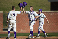 Jordan Sergent (9) of the High Point Panthers is greeted at home plate by teammate Austen Zente (5) after hitting a two-run home run against the NJIT Highlanders at Williard Stadium on February 19, 2017 in High Point, North Carolina. The Panthers defeated the Highlanders 6-5. (Brian Westerholt/Four Seam Images)