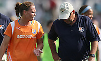 Sky Blue player/coach, Christie Rampone, 3, talks strategy with assistant coach, Mike Lyons, on the way to the locker room at halftime.  Sky Blue defeated the Freedom 2-1 in the first WPS playoff game at the Soccerplex in Boyds, Maryland.