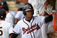 Cristian Pache (25) of the Rome Braves on the South team is greeted after scoring a run at the South Atlantic League All-Star Game on Tuesday, June 20, 2017, at Spirit Communications Park in Columbia, South Carolina. The game was suspended due to rain after seven innings tied, 3-3. (Tom Priddy/Four Seam Images)