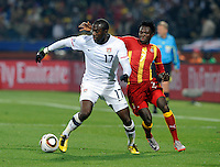 Jozy Altidore of USA and Samuel Inkoom of Ghana. USA vs Ghana in the 2010 FIFA World Cup at Royal Bafokeng Stadium in Rustenburg, South Africa on June 26, 2010.