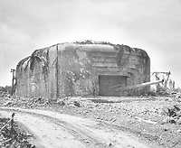 """Monster Nazi gun battery silenced in France.  This German gun emplacement has walls of concrete 13 feet thick and four guns each with a 10 1/4"""" bore.  This particular position was bombed out of action by Allied flyers. Ca. 1944. Albert Thompson.  (Coast Guard)<br /> Exact Date Shot Unknown<br /> NARA FILE #:  026-G-2513<br /> WAR & CONFLICT BOOK #:  1046"""